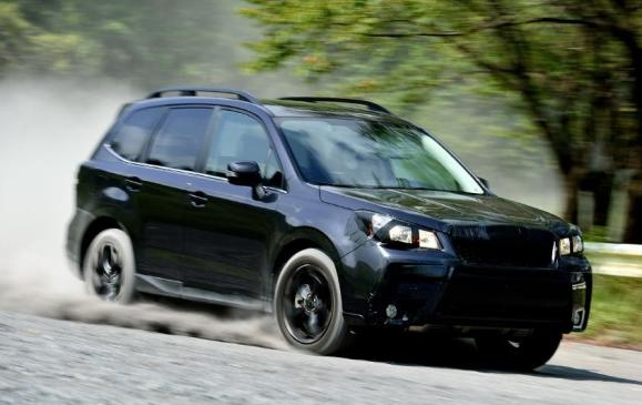 2014 Subaru Forester - front 3/4 view motion camouflage dirt road