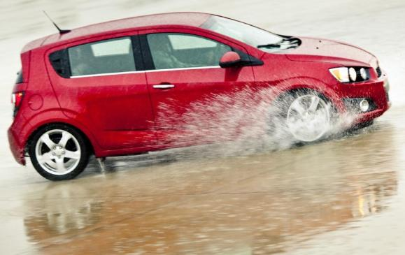 2012 Chevrolet Sonic - side view motion wet