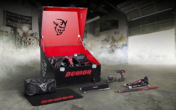 <p>At the lofty price of $1, the Demon Crate is the no-brainer option of the century. It contains niceties such as a fender cover and tool bag but also useful items such as a floor jack, a cordless impact gun, a tire pressure gauge and a proper torque wrench, with extension and socket, all with the Demon monogram or logo. Also in the Crate is a plate for the passenger mirror, narrow front tires for the drag strip, on five-spoke wheels, a performance air filter, plus the control module that calibrates the engine for high-octane fuel and the switch to activate it.</p>