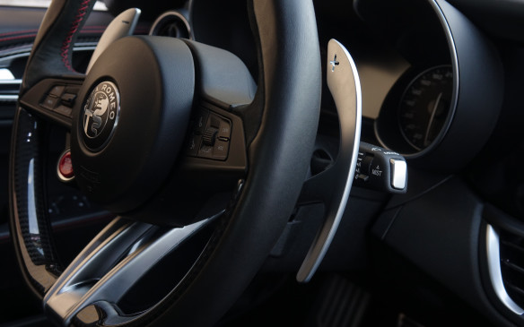 <p>Standard in the Quadrifoglio and included with the optional Sport package are these tall, aluminum shift paddles with the plus and minus symbol neatly cut out at the top. Their height is dictated by the fact that they are mounted on the steering column, rather than behind the wheel, and must be easily reached if you need to shift, down or up, while the wheel is turned. The paddles work quite well with manual modes that provide exceptionally quick shifts for conventional, torque converter-based automatic gearboxes, in both the Quadrifoglio and Ti models.</p>