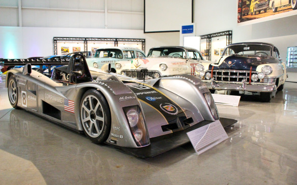 "<p>The distinctive Cadillac styling was even adapted to the brand's race cars – including this 2002 LMP 02 racer designed to compete – with limited success – at Le Mans. It continues on today's <a href=""http://www.autofile.ca/en-ca/car-photos/why-cadillac-racing-is-not-an-oxymoron"">DPiV.R</a> competitors in the IMSA endurance racing series. In the background are Cadillac racers from an earlier era.</p>"