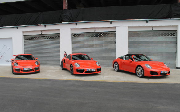 <p>We shared time with the new Targa, on the right here, which has the smaller, 420-horsepower engine but also comes standard with all-wheel-drive. Instructors familiar with the track led the way in the GT3 RS on the left, the race-ready 911 that comes stock with a roll bar and 500-horsepower naturally-aspirated engine.</p>