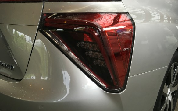 <p>A band of LED lights dominates the rear fascia, just below the built-in spoiler on the trunk lid, which opens with a touch of a sensor button. Large, bold tail light assemblies accent the rear corners of sleek body.</p>