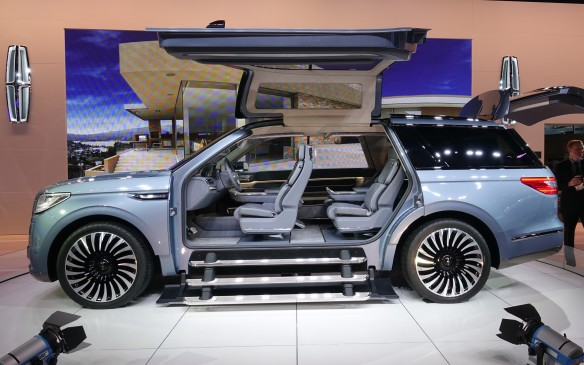 <p>The gigantic butterfly doors, pillar-less body openings and triple floorboards have no chance whatsoever to make it to production. But they sure look good on the show floor, and in a photo gallery.</p>