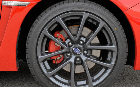<p>The WRX brakes via 316 mm ventilated rotors in front and solid 286 mm rotors at the rear. On the Sport-tech RS versions, they come equipped with Jurid brake pads that provide better power and fade resistance. Their calipers – dual pistons in front and single at the rear – are also painted red. The 245/40 Dunlop SP Sport Maxx tires and new 18-inch alloy wheels come with all Sport-tech models.</p>