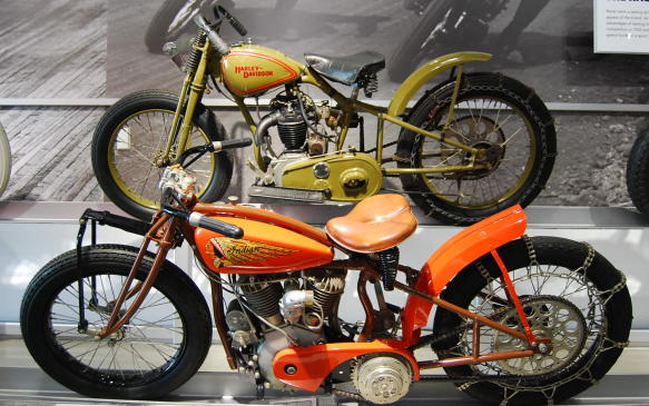 """<p><strong></strong></p> <p><strong>Steep Competition:</strong> Hillclimbing, which began as a simple promotional effort, (by Indian's chief engineer), became a sport in which riders competed in uphill speed and distance competitions.</p> <p>Both Harley-Davidson and Indian quickly began limited production of factory built hillclimbers based on learnings from their board- and dirt-track race machines of previous years, but both firms were forced to scale back production due to slow sales during the Great Depression. Nevertheless, hillclimbing remained popular.</p> <p>Harley-Davidson hillclimb motorcycles housed engines nicknamed """"Peashooters"""", the name believed to have been given to them because of the exhaust note of their small-displacement engines.</p> <p>One of only five factory-built Model G hillclimbers is shown here.</p> <p>***</p> <p><strong>First to the Top:</strong>In 1901, Indian's chief engineer Oscar Hedstrom, demonstrated Indian's first motorcycle, the Camelback prototype, by riding it up a steep gravel slope in Springfield, Massachusetts.</p> <p>This successful event garnered such attention, that pre-production orders sky-rocketed and gave birth to the uphill speed and distance races we know of today as hillclimbing.</p> <p>It wasn't long before a third firm began to appear in the hillclimbing motorcycle market, Excelsior completed the sport's """"Big Three"""" but wasn't around long enough to really compete. It exited the market in 1931. Of the """"Big Three"""" motorcycle manufacturers, Indian was the first to produce a factory-built hillclimber.</p> <p>The """"Altoona"""" model, shown here, was developed specifically for a hillclimb in Altoona, Pennsylvania and housed an alcohol-burning 80-cubic inch V-Twin engine.</p>"""