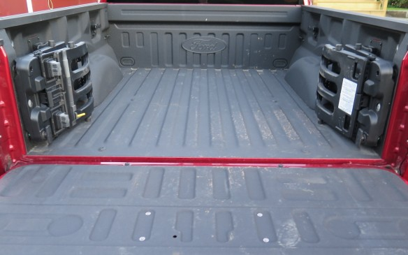 <p>That bed or box is relatively short in this CrewCab configuration where the occupant space is more important than cargo capacity. However there are fold-out box extenders to allow for longer items, with the tailgate lowered.</p>