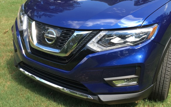 "<p>Fresh styling touches include a new front fascia highlighted by what Nissan dubs a ""V-Motion"" grille, a design cue that's become a signature look for the brand. The headlamp assemblies, which now include LED daytime running lights, have been redesigned to draw the eye along the side of the Rogue and connect with the new taillights.</p>"