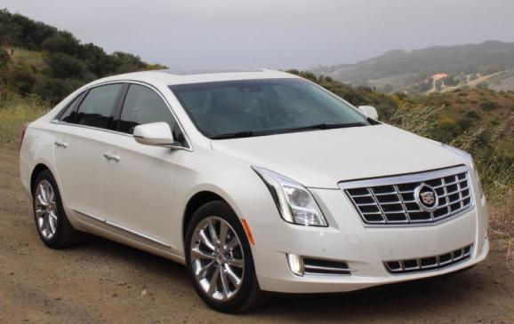 2013 Cadillac XTS - front 3/4 scenic