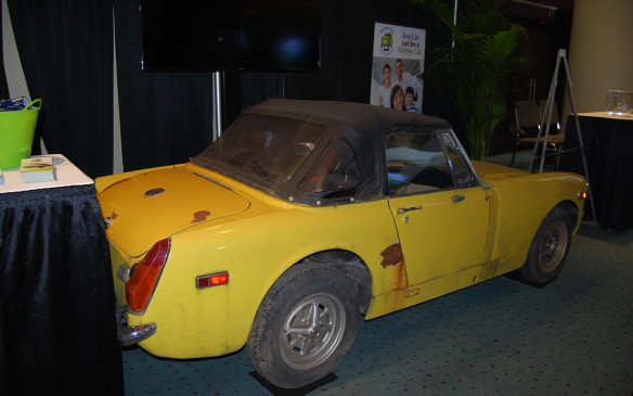 "<p>But it may be a gem in someone else's eyes. Not all cars at the show are … clean.  Or new, for that matter.  But that doesn't mean they're unimportant. This car in particular was on display in the Kidney Car booth.  ""Any car can be a Kidney Car"".  Yup. Those who donate their cars for a good cause are the gems. And they get a tax receipt for their good deed.</p>"