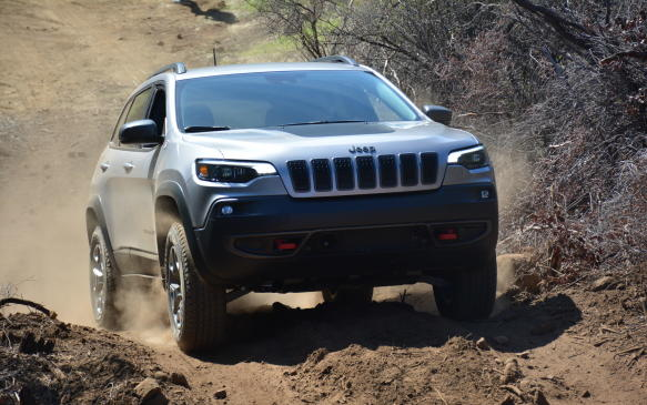 <p>We drove the second-from-the-top Trailhawk trim model for the off-roading portion of the new Cherokee's first drive program in Westlake Village, California. It comes with a locking rear differential, hill-ascent and descent controls and an increase in ground clearance by 25 mm (1 inch). In addition, a two-tone paint job on the hood, signature red tow hooks and skid plates provide both rugged style and substance.</p>