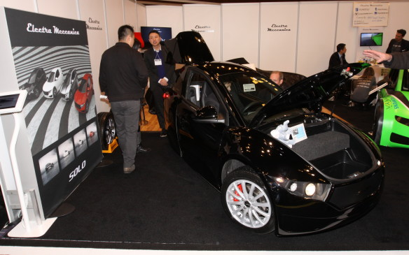 <p>The Electra Meccanica booth was a busy place, as people clamoured for a look at the Solo commuter car, and the new performance version of it with big brakes and wheels, and racing slicks, no less. The plan is to have a spec-racing series for them.</p>
