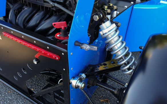 """<p>The Talisman's rear suspension is also triangulated but has a different design that combines rods with a girder-type, welded upper arm. Coil-over shocks again offer a measure of ride-height adjustment. The small side lights and rows of red LEDs are for those late evening track sessions and the red, rotary kill switch just above a familiar fixture on track cars. The compact battery is hidden at the bottom, under cut-outs that let hot radiator air flow out. DC Competition has not announced official prices yet but a track-ready Talisman should go for about CAD$30,000.</p> <p>For further information about the Talisman project contactDaniel Campagna via his <a href=""""http://campagna1.com/"""">website</a>.</p> <p></p>"""