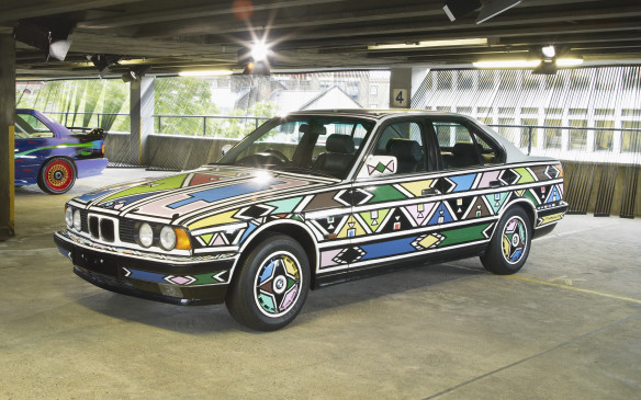 <p>On display in London in 2012, South African Artist Esther Mahlangu's  BMW 525i Art Car design references patterns found in the clothing and jewelry of her Ndebele people. The colorful and geometric patterns she uses are typical of her work. It's  tradition of her native people for women to paint the exterior of houses.</p>