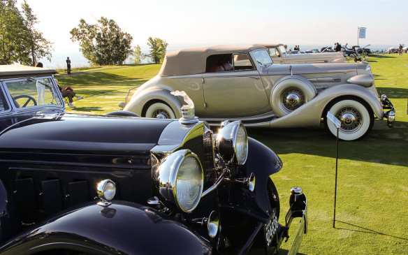 <p>From the same Classic era, Packards had a class of their own. The second car in this photo is a 1936 Packard Twelve with a novel Victoria body style. But pay particular attention to the radiator cap ornament on the 1931 840 Roadster in the foreground.</p>