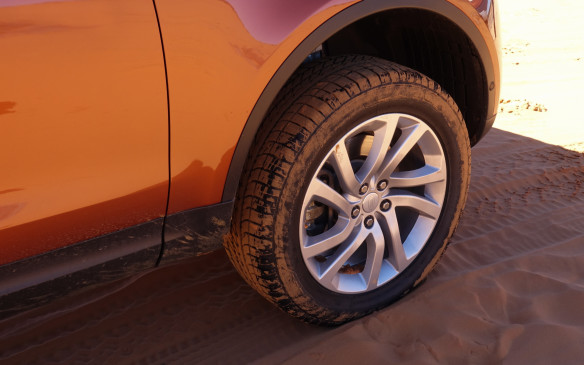 <p>The diesel-powered Discovery Td6 proved a more than able off-roader with its regular, all-purpose, Goodyear Eagle tires, in size 255/55R20. To navigate the deep, silty, orange-coloured sand of spectacular Coral Pink Sand Dunes Park in Utah, our expert Land Rover hosts brought tire pressures down by more than half, from 34/37 psi front and rear to radically lower values of 15/18 psi. This was to lengthen rather than widen the tires' footprint in order to maximize traction in deep sand.</p>