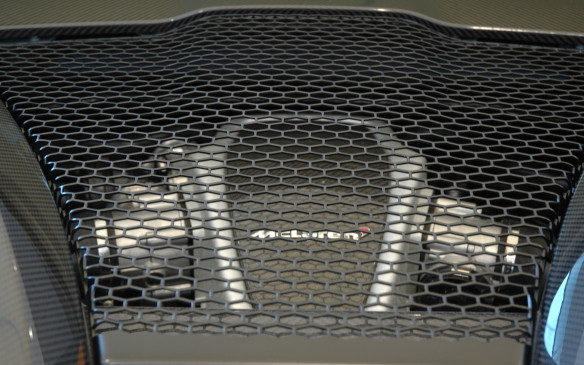 <p>Lurking beneath the mesh is a somewhat detuned 570-horsepower version of McLaren's corporate 3.8-litre twin-turbo V-8 engine (a 540-hp version was also just announced for the 540C). Combine 570 horsepower with the lowest mass in its class and McLaren claims 0-100 km/h in 3.2 seconds and a top speed of 328 km/h.</p>