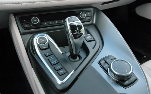 <p>The centre-console control layout will look familiar to most owners of modern BMWs, with a couple of wrinkles specific to the i8. An eDrive switch by the start/stop button lets you select electric-only driving (subject to speed and battery state of charge) while the drive mode selector has just Comfort or EcoPro settings. To get Sport mode, you toggle the shifter over to the left.</p>