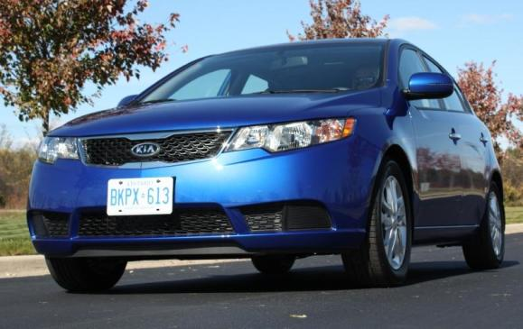"""<p><strong>2010-13 Kia Forte</strong></p> <p>Kia's tagline has a ring of truth for Forte owners who continue to be surprised by this compact car's crisp styling, roomy interior, quiet ride and boatload of features. It took the shape of a four-door sedan and two-door """"Koup;"""" a handy five-door hatchback debuted for 2011. The Forte's somewhat plasticky cabin was loaded with standard gear including Bluetooth phone connectivity, satellite radio, stability control, front-side and curtain airbags and active front head restraints.</p> <p></p>"""
