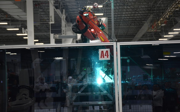 <p>The 360-degree rotisserie-style welding machine helps turn the entire car structure allowing optimal access for the robotic weld arms to work their magic. The space frame used is created with 100% robotic MIG welding, an industry first. The robots provide precise positioning of each of the 860 MIG welds along the space frame.</p>