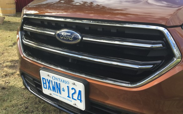 <p>The new horizontal-bar grille, which reflects the new corporate look found on bigger siblings in Ford's truck/SUV lineup, helps give the Escape a wider, more rugged look.</p>