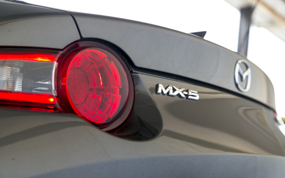 <p>Up to this point, the Mazda seems like the runaway winner; the sure bet if you're looking for a fun machine, but there is a price to pay for all that fun, and it's quite literally, a much higher price. At $48,000 CAD after Freight and PDI are factored in, the MX-5 RF optioned as ours was in GT trim with the Grand Sport package, is nearly $14,000 more than our top-tier BRZ Inazuma Edition. That kind of price difference could buy a lot of track days and sets of tires and brakes to enjoy the BRZ at its full potential.</p> <p>As much as I love the endlessly playful nature of the MX-5 RF (heck, I still consider the previous generation MX-5 I once had to be the most fun car I've ever owned), the BRZ is nearly as entertaining, but it just makes more sense as an actual daily-drivable car.  Its trunk and albeit tiny back seat lend a modicum of practicality, and that price deficit simply can't be ignored. </p>