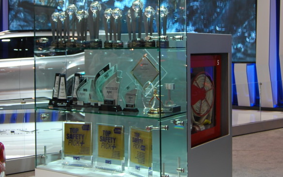 """<p>A trend we have seen growing these last couple of years is the displayof awards to automaker's booths. In this case, Subaru has an entire glass case for their many awards to be seen by all. Other automaker's typically display one or two on a pedestal. There are even gems in the form of the trophies themselves.</p> <p>So let the hunt begin. I bet you can find a """"gem"""" somewhere in pretty much every exhibit at the show. Go for it!</p>"""