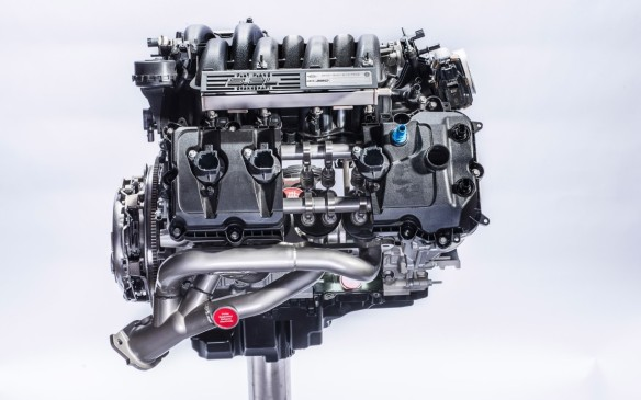 <p>The GT350/350R's engine weighs five kilos less than the regular 5.0-litre and has a 12.0:1 compression ratio. It's topped with a pair of 16-valve aluminum heads with hollow intake valves and sodium-filled exhaust valves that are larger and spaced further apart than in the regular V-8. The bottom end is covered by a composite oil pan with built-in windage tray to keep the 10 quarts of oil from sloshing around in the turns.</p>