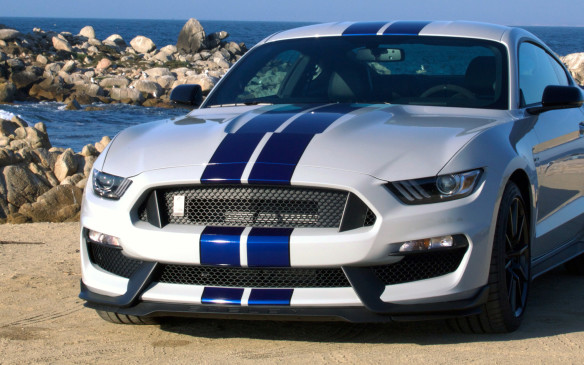 <p>But the new Shelby GT350 is more than just an engine, it is a rolling showcase of technology and Ford's global racing experience. While based on the current Mustang, the Shelby GT350 differs visually in several areas inside and out. The front-end is all-new, heavily influenced by aerodynamic considerations. The redesign is meant to reduce lift at the front and encourage cooling airflow for the engine and transmission.</p>