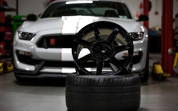 <p>The GT350R gets a set of carbon-fibre wheels. These exclusive units are an amazing six kilos lighter than the aluminum alloys on the GT350 – each! The center section of the front wheels are covered in a ceramic layer to insulate them from the tremendous heat generated by the brakes on the race track. The Shelby wears nineteen-inch wheels. Those on the standard Mustang are 7.5-inches wide in front and 9-inches in back. Those on the Shelby GT350 are 10.5/11 and on the GT 350R 11 and 11.5</p>