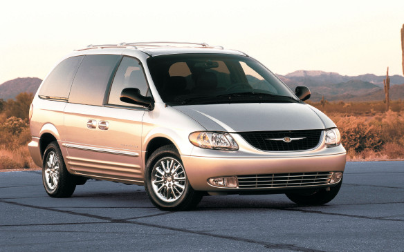 <p>In 2001, now merged with Daimler, Chrysler debuted the fourth generation of the minivan with an industry-first power liftgate in the Town & Country. It also featured power sliding doors, on both sides, with industry-first opening direction obstacle detection and in-door motors.</p>