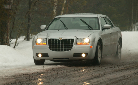 "<p>Mainstream product styling took a major turn again with the introduction of the 2005 Chrysler 300 series, trading the sleek, smooth lines of the LH-model years for a more upright formal look, with a very shallow greenhouse. It also marked a return to rear-wheel drive – a positive by-product of the Daimler connection – and included the 5.7-litre Hemi-powered 300C model with 345 horsepower. The new 300 was named ""Car of the Year"" by Motor Trend. Adding even more performance to the lineup, the 425-horsepower Chrysler 300C SRT8 featured a 6.1-liter Hemi engine, four-piston Brembo brakes, performance styling, suspension and exhaust, and was capable of 0-60 mph times in the low 5-second range.</p>"