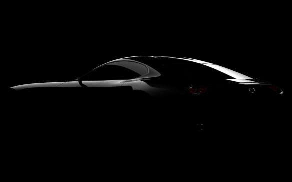<p>Teaser image of new Mazda sports car concept to be unveiled at 2015 Tokyo Motor Show</p>