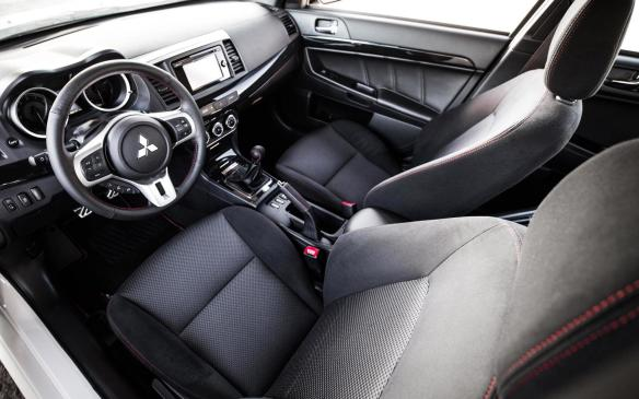 <p>2016 Mitsubishi Lancer Evolution Final Edition cockpit</p>