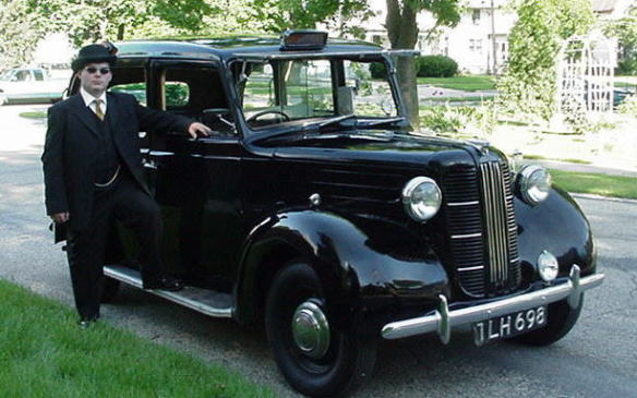 <p>Probably the granddaddy of the Black Cab, the Austin FX3 was officially adopted as the London Taxicab in 1953, and stayed in active duty until 1958 when it gave way to the iconic Black Cab look that is still evident today. Many of the models retired from active duty on London streets made their way to other parts of England, where they continued as functional taxis until they couldn't drive any more. The FX3 was the last taxi to have the left-side open luggage platform beside the driver, as its replacement the FX4 was the first four-door taxicab to navigate London streets.</p>