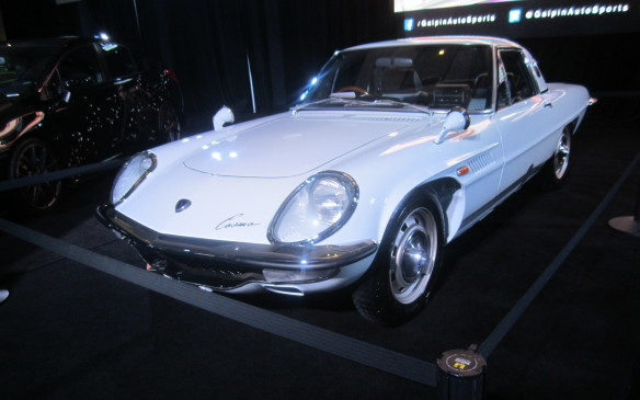 <p>It wasn't on the Mazda stand but this Cosmo coupe, tucked away among a collection of customs and hot rods, represented the Japanese brand's rotary-engined roots.</p>