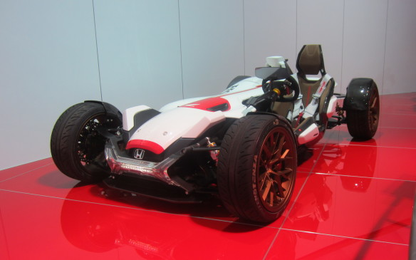 <p>Honda's 2&4 concept is, in effect, a four-wheeled motorcycle with a 15,000-rpm V-4 engine right out of the company's MotoGP racing bike. Don't ask about the side-impact protection.</p>