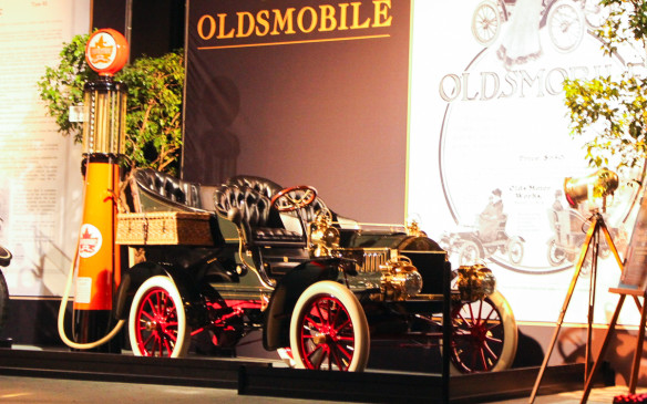 <p>The oldest car in the exhibit was this Canadian-built 1904 Oldsmobile Model T with a 'French Front', which was an artful illusion. It suggests that there is an engine up front but in fact the single-cylinder powerplant is located beneath the floorboards as on the original 'Curved Dash' model that preceded it. As the best-selling car of its day, the Oldsmobile warranted what were then highly artistic ads.</p>