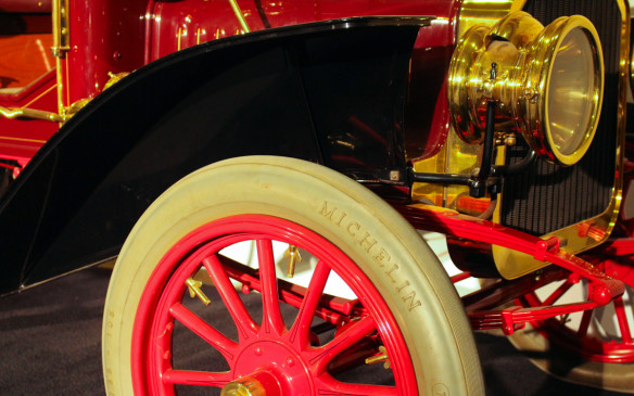 <p>Michelin was already well established in the tire business in those early days, before all tires were coloured black. The model F even came with a Michelin tool kit.</p>
