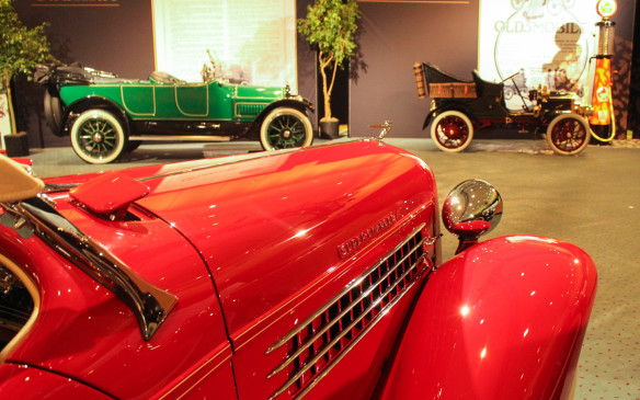<p>The 17 concours-quality cars presented in an art gallery-like setting were works of art themselves. And so were the corresponding ads that formed the backdrops for most of those cars.</p>