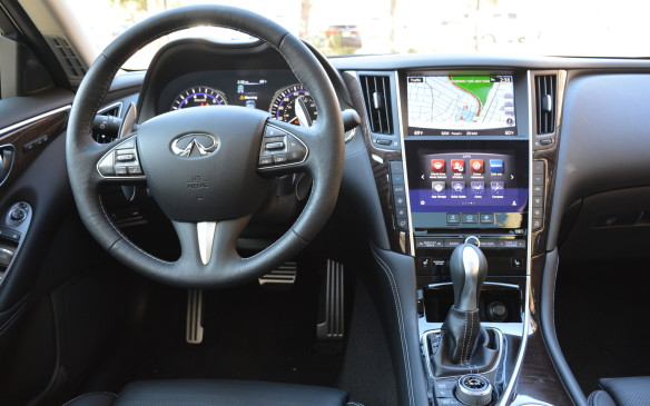 <p>The interior design is nicely sculpted with an open and sweeping but organized theme. Many premium touches exist creating a sophisticated, yet modernly-styled cockpit. Infiniti's InTouch infotainment system is the central feature. It has a dual screen with the eight-inch top sceen typically used for navigation, while one can scroll through the seven-inch bottom sceen for climate control, audio, or customizable driving preferences.</p>