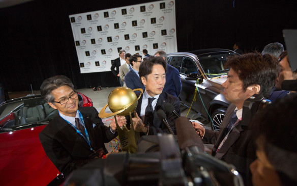 <p>MX-5 Program Manager Nobuhiro Yamamoto and Mazda North America President Masahiro Moro address the press while holding the overall winner's trophy for the Mazda MX-5 at the World Car of the Yearceremony. The World Car of the Year Awards are supported by partnerships with Autoneum, Bridgestone, The New York Auto Show, Prime Research, KPMG and Newspress.</p>