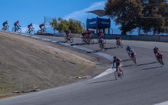 Cyclists start 16-storey drop from Laguna Seca's Corkscrew