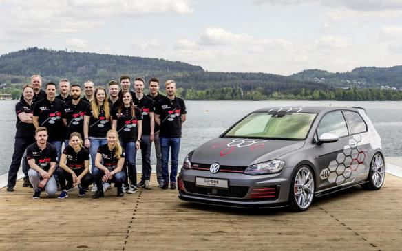 <p>Volkswagen Golf GTI Heartbeat with its creators</p>