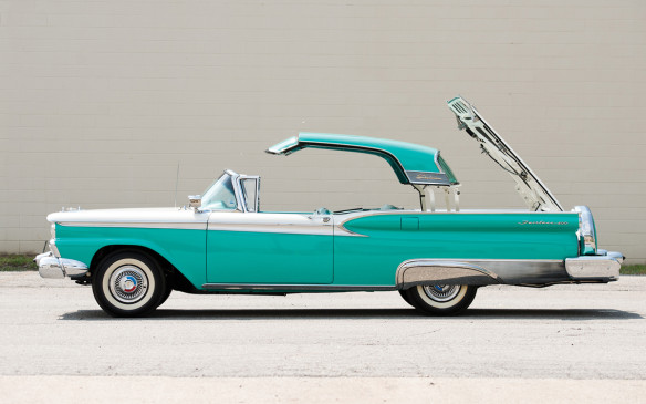 """<p>Long before the modern retractable hardtop was """"invented,"""" Ford was marketing a full size 2-door sedanwith a power operated hard top on its 1957 Fairlane. The design required a shorter cabin and longer trunk than the traditional Fairlane, with the roof over the 4-seat cabin stowing itself in the trunk almost intact (only a front panel folded under to save a bit of space) and pretty much taking up all usable trunk utility.</p>"""