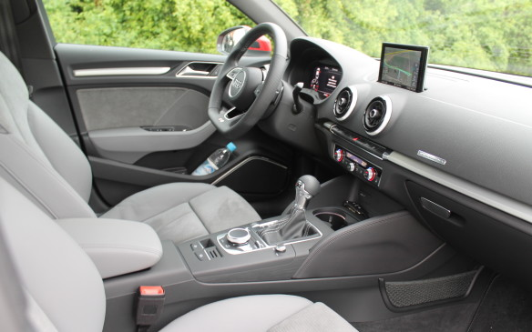 <p>The interior is very comfortable. The seats are firm, but they're supportive in all the right places. The main display screen raises in the central instrument panel when in use.</p>
