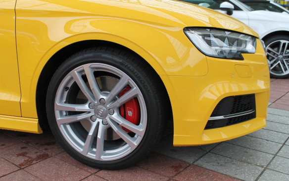 <p>All A3s come standard with 17-inch, five-spoke wheels, and with automatic start-stop that turns off the engine when the car's at a standstill, to help save fuel. The S3 seen here has standard 18-inch wheels and red calipers.</p>