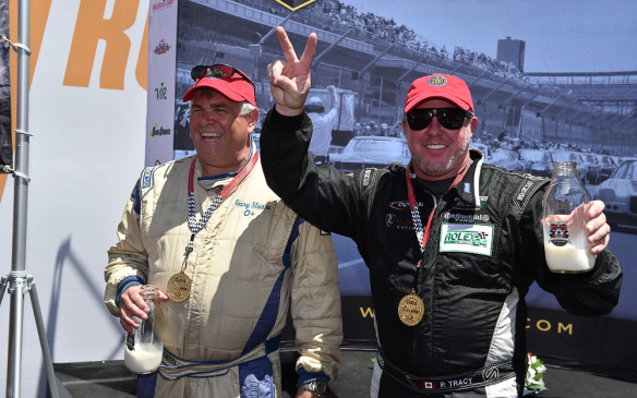 <p>Paul Tracy finally got to drink the milk that's traditionally given to the Indy 500 winner. He was denied that opportunity after winning the 500 on the track in a disputed finish in 2002, ultimately losing a proteston a technicality.</p>