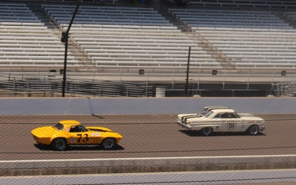 <p>Other lesser-known models included this V-8 powered 1964 Ford Falcon Sprint, a pre-cursor to the Mustang, seen here leading a '66 Corvette Sting Ray. As is evident from the stands in this photo, the vintage race was more a competitor event than a spectator event.</p>
