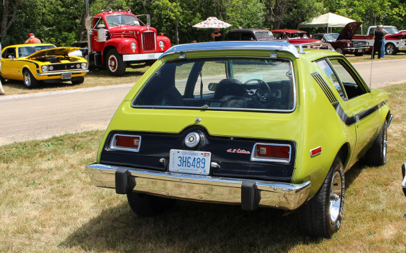 <p>Tesla wasn't the first automaker to offer a model X. This '74 AMC Gremlin X reflects its era with its lime green colouring and the use of tape stripes.</p>